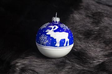 Christmas ball on black fur
