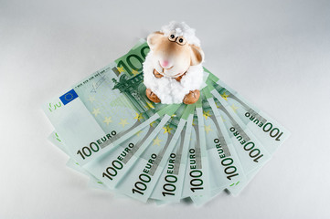 toy sheep on banknotes 100 euro