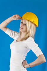 portrait of a beautiful woman in the construction helmet