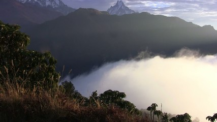 Thick clouds cover the ground in the Himalayas. Nepal.