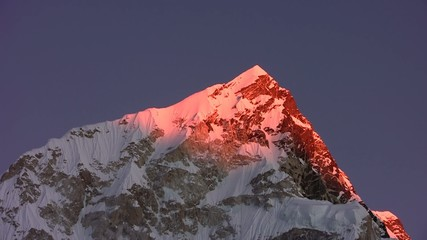 Sunset in the Himalayas. Nuptse Peak. Nepal. Time lapse.