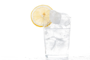 Glass of soda with a slice of lemon