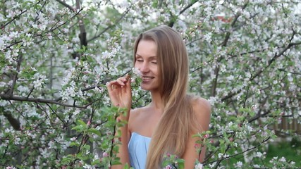 Beautiful girl in flowers