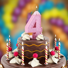 Birthday cake with number 4 lit candle