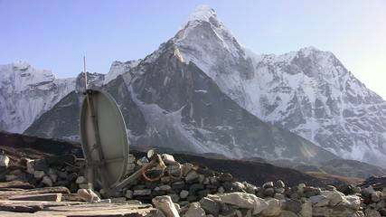 Satellite dish on the Ama Dablam background. Nepal.