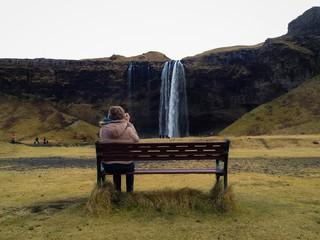 Woman enjoys Icelandic waterfall