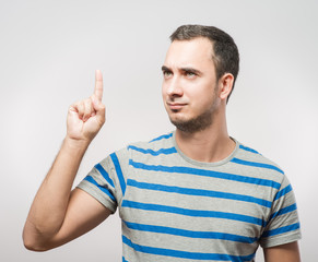 Young man pointing  up