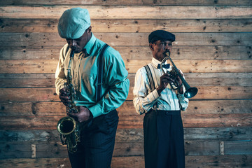 Two african american jazz musicians playing trumpet and saxophon