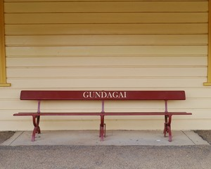 A bench on a platform of Gundagai station in Australia