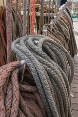 Mast and sail ropes on the deck of a Tall Ship sailing vessel.