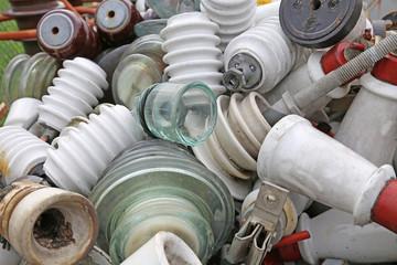 old ceramic insulators in an old dump obsolete material