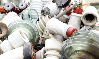 ceramic insulators in an old dump obsolete material and hazardou