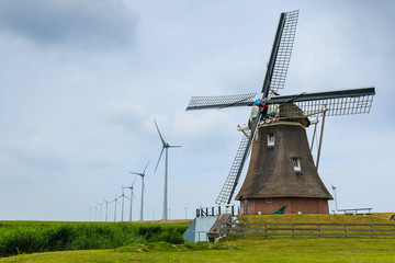 Old windmill and new wind turbines