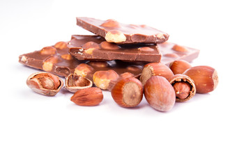 chocolate with hazelnuts on white background