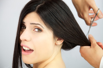Woman surprised about getting long hair cut
