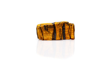 Tiger's eye gem stone rough isolated white