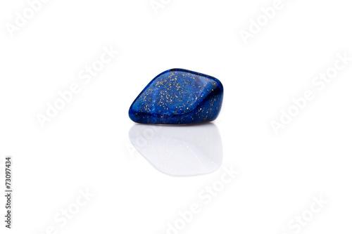 Beautiful blue lapis lazuli gem stone isolated