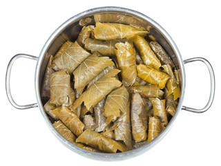 dolma from vine leaves and mince in stewpan