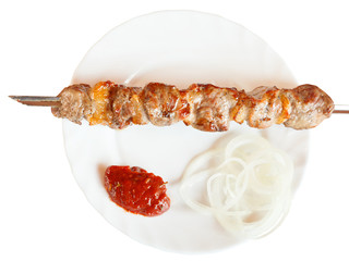 top view of skewer with lamb shish kebab isolated