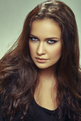 Portrait of beautiful young woman with long brown hair