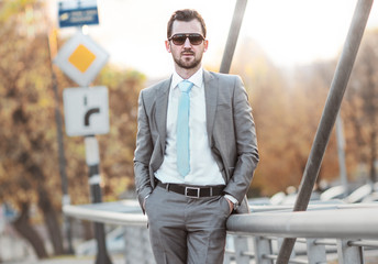 Young gorgeous businessman posing