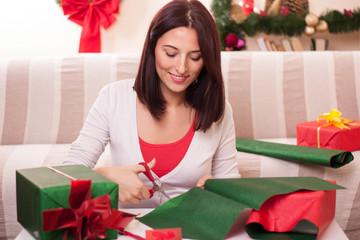 Wrapping Christmas gift.