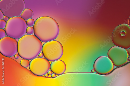 colorful drops of oil and air bubbles on the water - 73099248