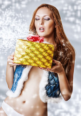 Young sexy woman santa claus