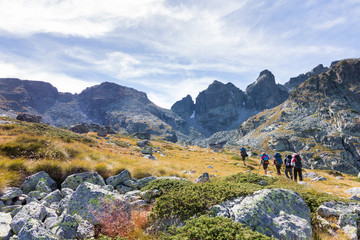 Group backpackers walking mountains. Rila range, Bulgaria.