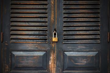 Close up black door with key lock