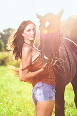 Young sexy woman with a horse