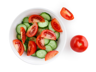 Sliced tomatoes and cucumbers on a white plate