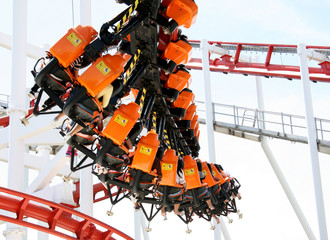 Rollercoaster ride with sky at theme park