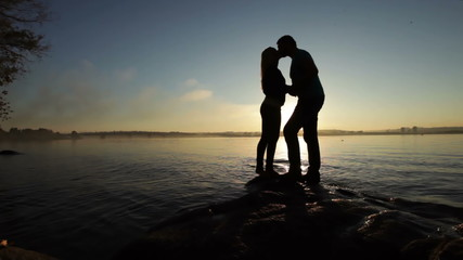Silhouette of couples at sunset