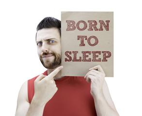 Man holding a card with the text Born to Sleep