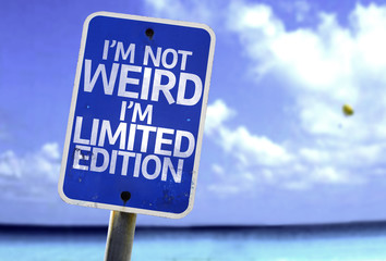 I'm Not Weird Im Limited Edition sign with a beach
