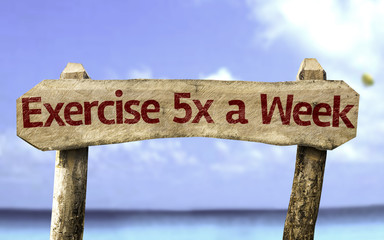 Exercise 5x a Week sign with a beach on background