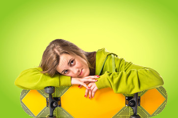 Blonde girl with skate over green background