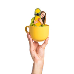 Pretty young girl wearing urban style inside cup of coffee