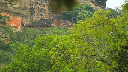 Tourists climb the mountain Sigiriya.