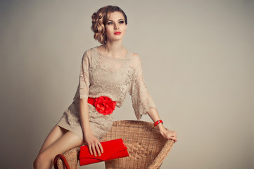 The girl in a grey dress with red accessories 1228.