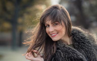 Beautiful young smile woman wearing fur