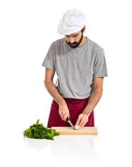 Chef cutting a garlic