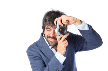Man photographing over white background