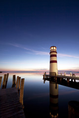 Beautiful mysterious lighthouse at night