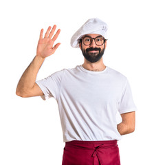 Chef saluting over white background