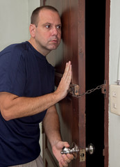 man listening at the door