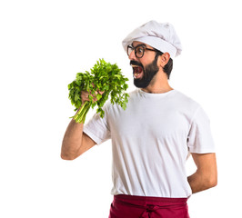 Chef holding lettuce over white background