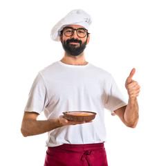 Chef holding cake