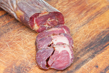 sliced horse meat sausage kazi close up on board